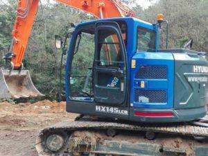 Retro excavadora orugas Hyundai HX 145